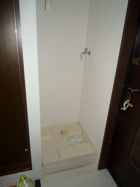 グリーンコーポ千成 1階 洗濯機置場