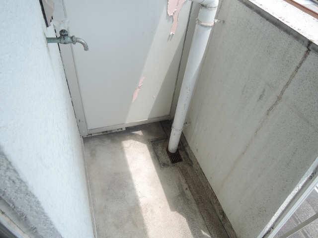 コーポ黒川 2階 洗濯機置場