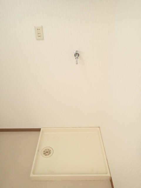 シュロス黒川 1階 洗濯機置場