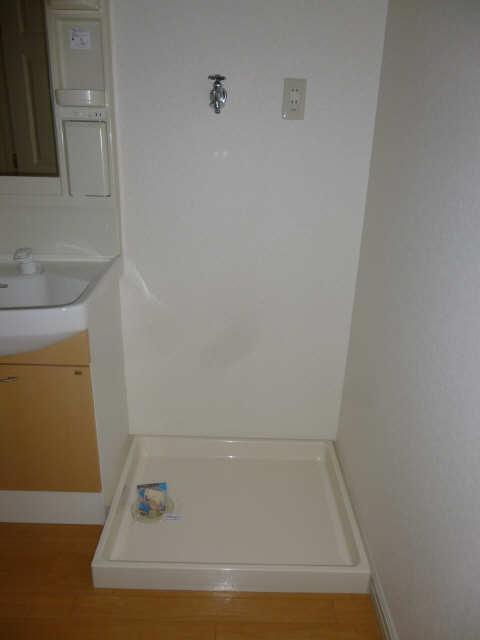 エタニティーローズ 1階 洗濯機置場
